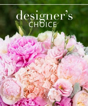 Custom floral arrangement in shades of pink, lavenders, and purple