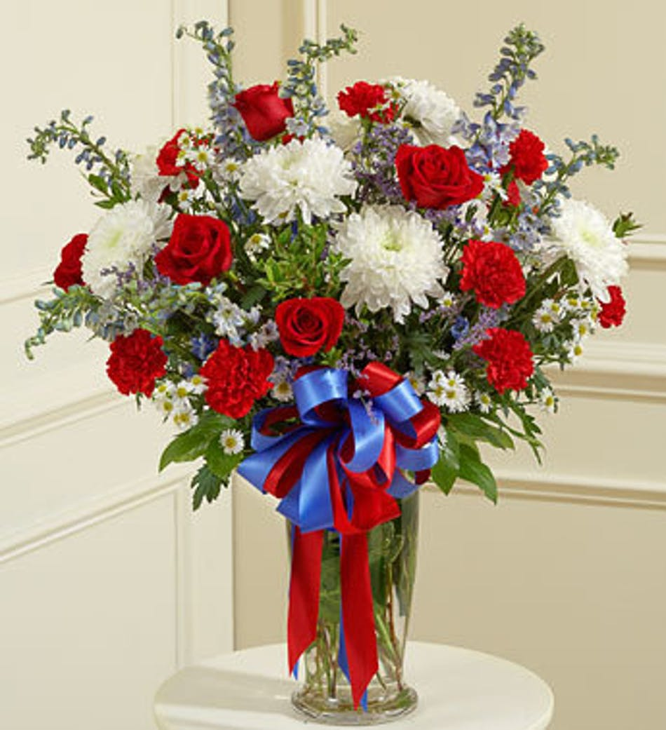 Funeral arrangement vase design in red white and blue delivery by 10am tomorrow available order within izmirmasajfo Image collections