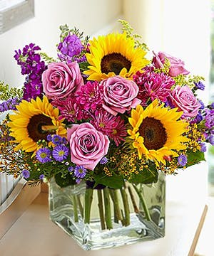 Sunflowers and roses flower arrangement by Carithers Flowers Atlanta