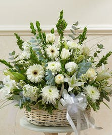 White garden florals featured in a floor basket