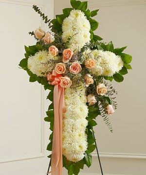A White Standing Cross with Peach Sash