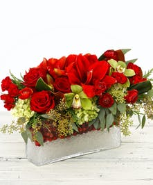 The Holiday on Ice table centerpiece features amaryllis, roses, hydrangea, orchids, magnolia and eucalptus.