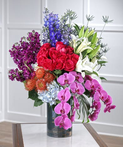 The Garden Romance featuring orchids, lilies, stock and hot pink roses