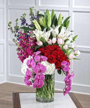 The Endless Love arrangement features hydrangea, roses, orchids, lilies and delphinium