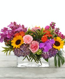Garden Bonfire features sunflowers, hydrangea, orchids and garden roses
