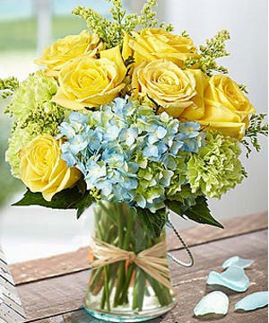 Beautiful flower arrangement of hydrangea and roses by Carithers Flowers Atlanta