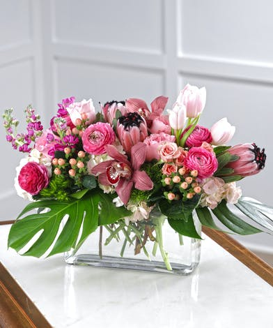 Pink Treasures delivers pink garden roses & tea roses, pink ranunculus, berry stock, pink exotic orchids and pink protea.