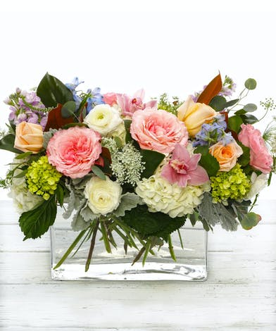 The Timeless Treasure featuring pink garden roses, ranunculus and orchids