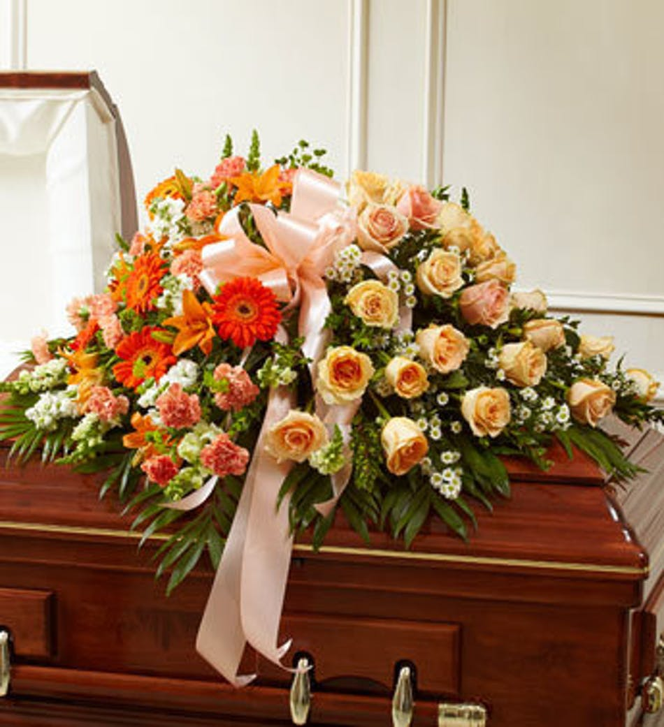 Elegant funeral casket cover in peach available for nationwide delivery izmirmasajfo