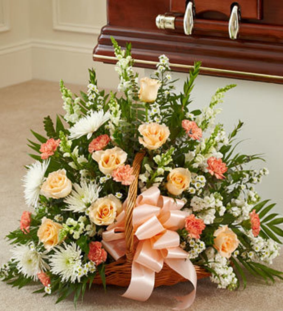 Funeral arrangement for woman in peach flowers available for nationwide delivery izmirmasajfo