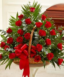 An Elegant Sympathy Basket of Red Roses