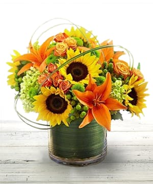 Sunburst Bouquet featuring orange lilies, sunflowers and roses