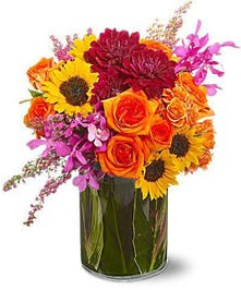 Sunflowers and orchids, fall flower arrangement by Carithers Flowers Atlanta