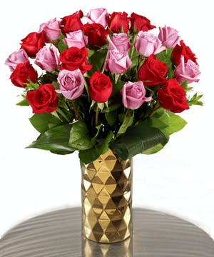 Farm-fresh luxury 'Love & Romance' Ecuadorian Mountain Roses featuring our 30% Larger Red, Pink, and Hot Pink Colors in a chic vase.