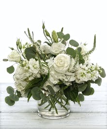 Dreamy Delights features white lisanthus, roses, ranunculus and garden hydrangea