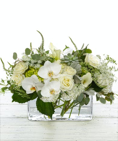 Midsummer Nights Dream features hydrangea, roses, succulents and orchids.
