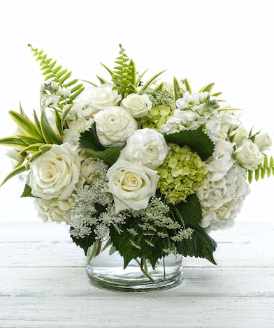 White Symphony Bouquet featuring hydrangea, roses, ranunculus and lush foliage.