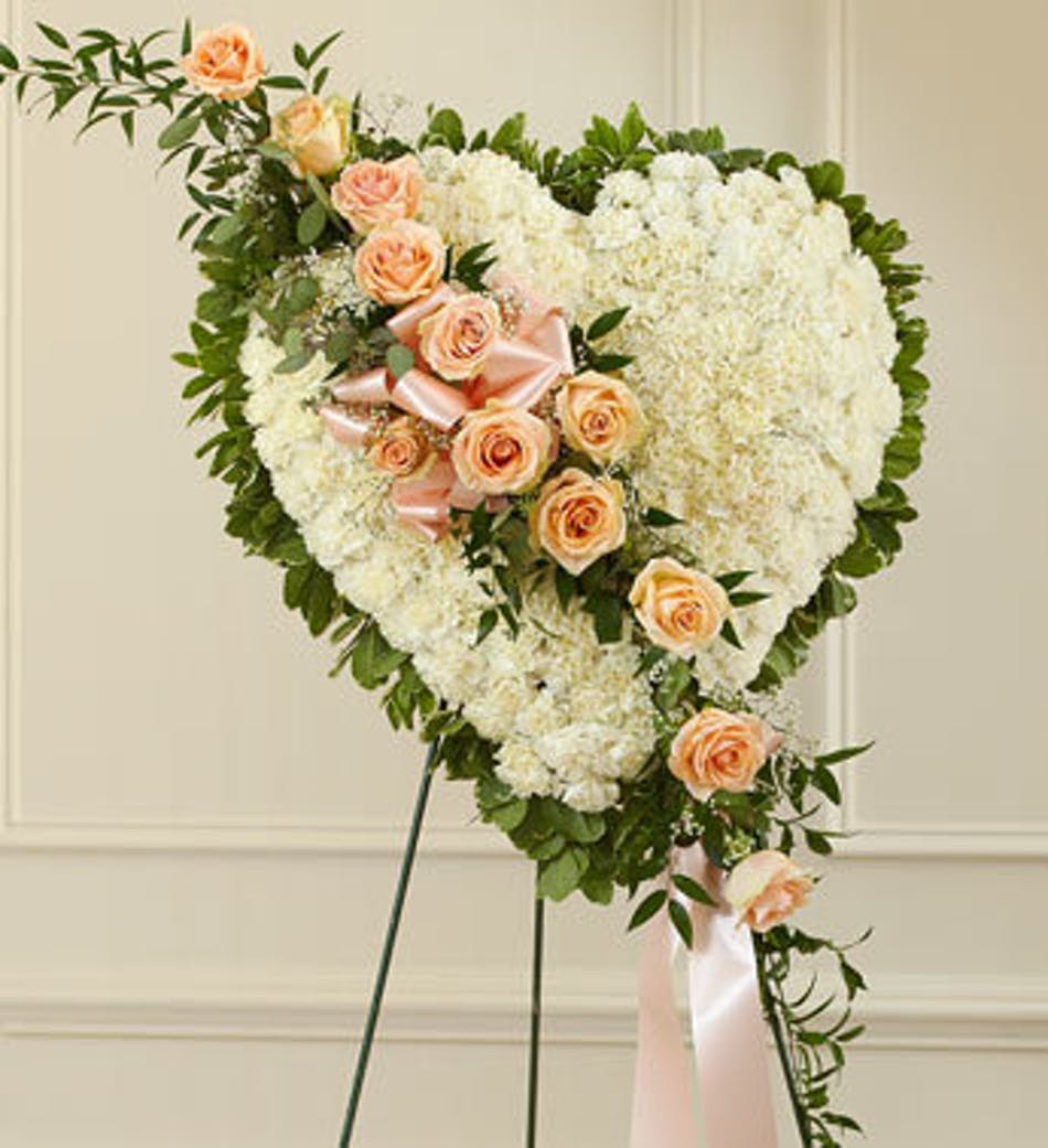 White Heart Funeral Arrangement With Peach Accent