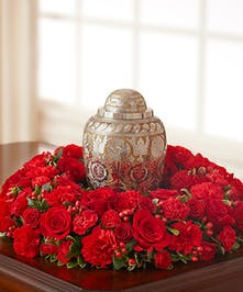 Rich table wreath of red roses, mini carnations and more