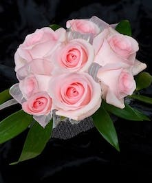 Pink sweetheart roses with wristlet