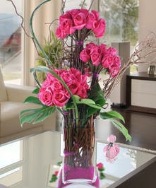 Carithers Flowers Masterpiece Collection, featuring hot pink roses and exotic flowers.
