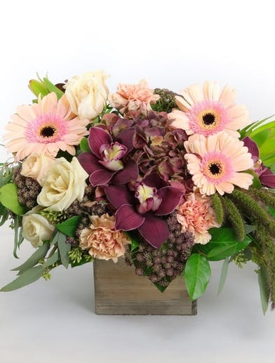 Farm to Table flower arrangement featuring hydrangea, orchids and roses