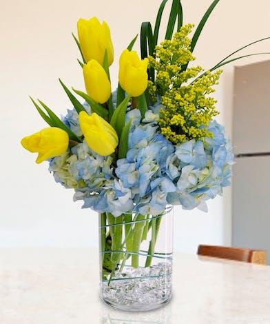 Springtime Tulip Bouquet Arrangement of yellow tulips and hydrangea