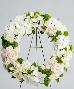 the Cherished Memories Wreath features hydrangea, roses, and orchids with same day delivery in Atlanta