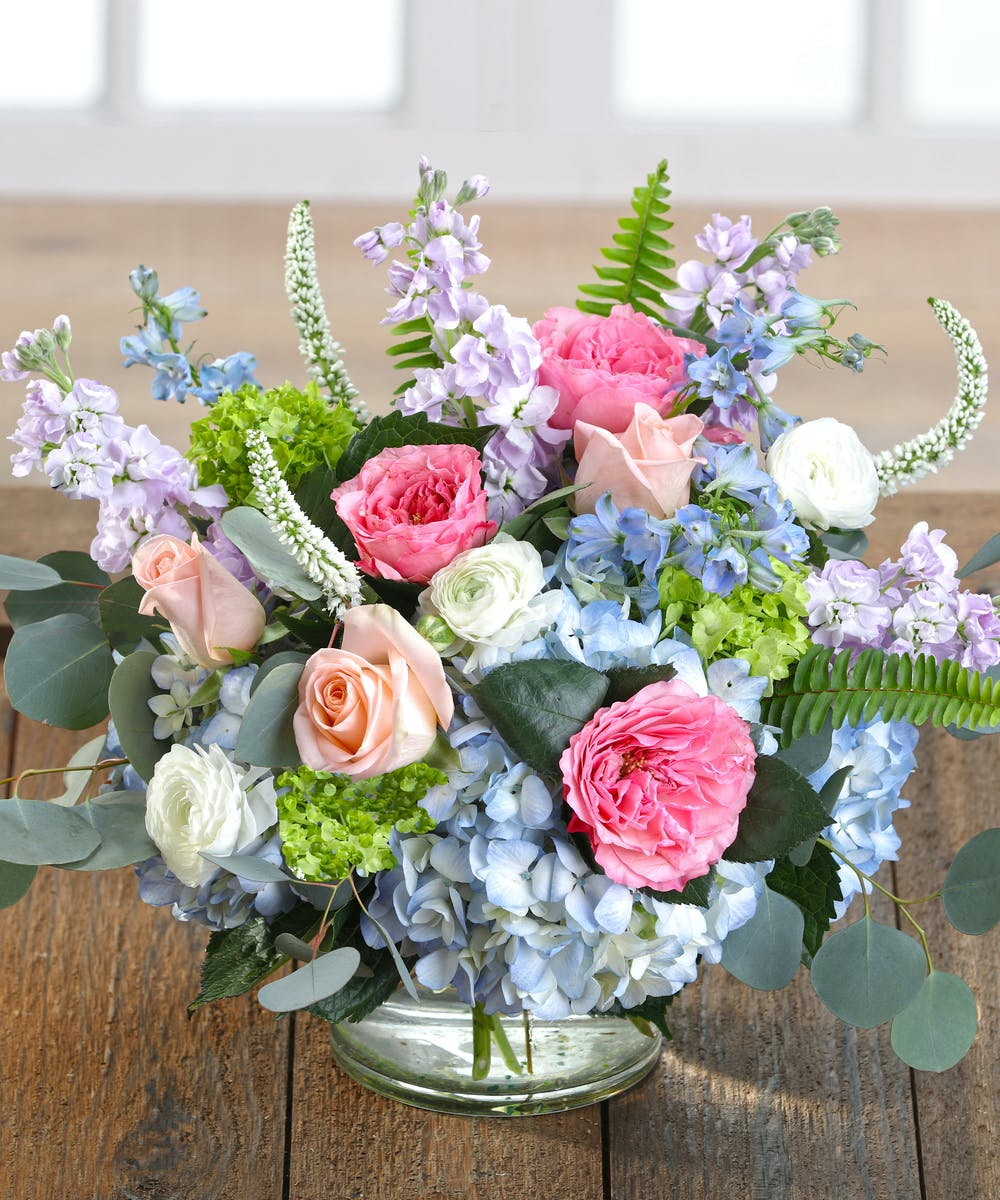 The English Cottage Bouquet Features Pastel Hydrangea Garden Roses Delphinium And Ranunculus Carithers Flowers Atlanta