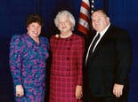 Larry and Jane Carithers in a posed photograph with Barbara Bush
